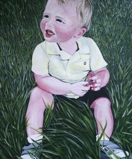Cute little boy in the grass