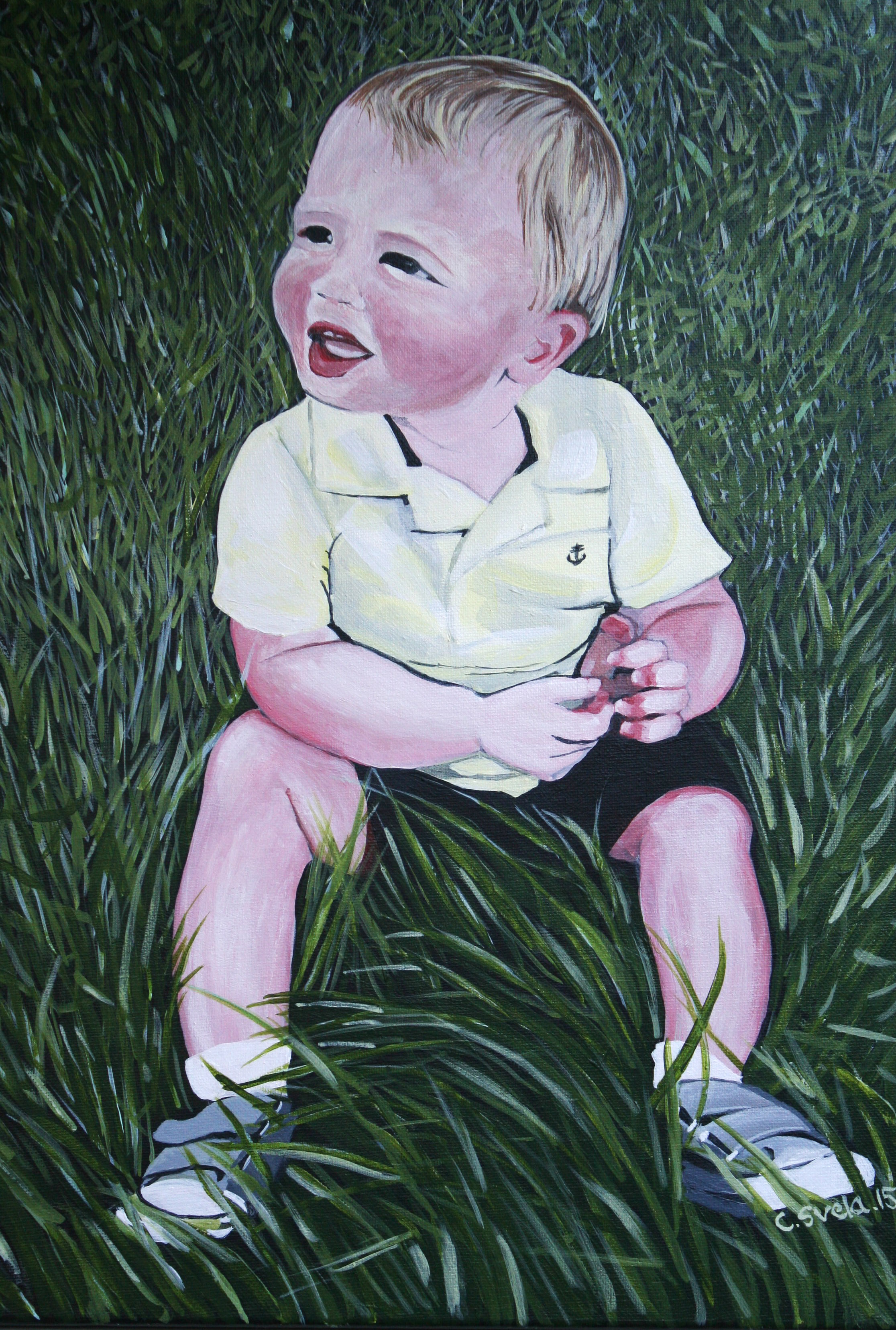 Little boy in the grass
